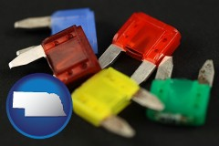 nebraska map icon and colorful automobile fuses