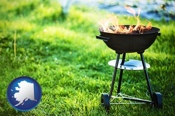 a round barbecue grill - with Alaska icon