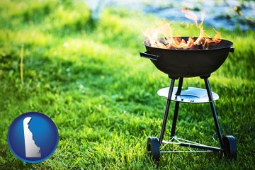 a round barbecue grill - with Delaware icon