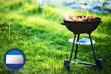 a round barbecue grill - with Kansas icon