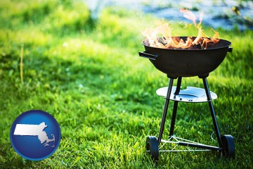 a round barbecue grill - with Massachusetts icon