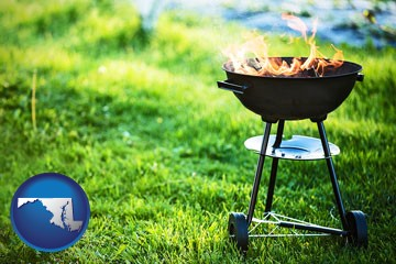 a round barbecue grill - with Maryland icon