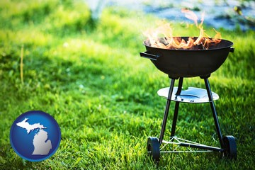 a round barbecue grill - with Michigan icon