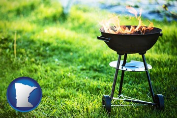a round barbecue grill - with Minnesota icon