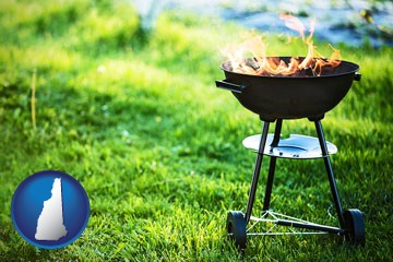 a round barbecue grill - with New Hampshire icon