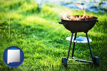 a round barbecue grill - with New Mexico icon
