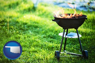 a round barbecue grill - with Oklahoma icon