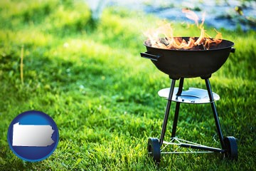 a round barbecue grill - with Pennsylvania icon