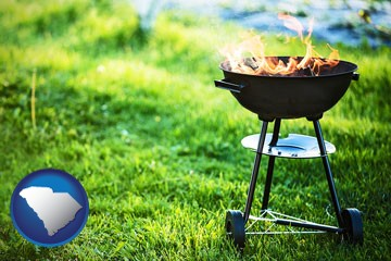 a round barbecue grill - with South Carolina icon