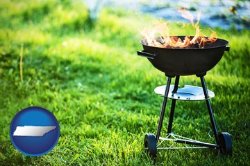 a round barbecue grill - with Tennessee icon