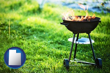 a round barbecue grill - with Utah icon