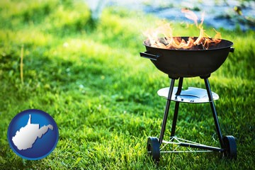 a round barbecue grill - with West Virginia icon