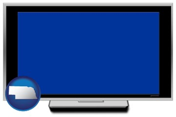 a big screen tv with blue screen - with Nebraska icon