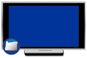 a big screen tv with blue screen - with Oregon icon