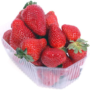 a transparent plastic box filled with red strawberries