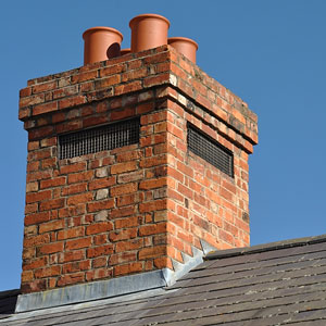a red brick chimney with four flues