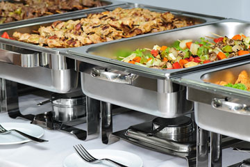 chafing dishes on a banquet table