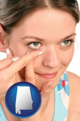 alabama a young woman inserting a contact lens