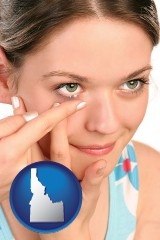 idaho a young woman inserting a contact lens
