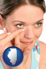 illinois a young woman inserting a contact lens