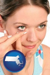 massachusetts a young woman inserting a contact lens