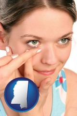 mississippi a young woman inserting a contact lens
