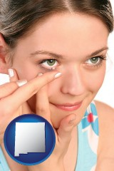 new-mexico a young woman inserting a contact lens