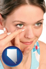nevada a young woman inserting a contact lens