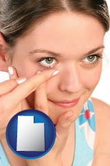 utah a young woman inserting a contact lens