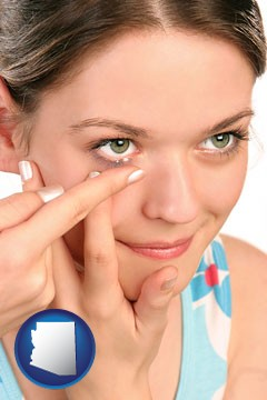 a young woman inserting a contact lens - with Arizona icon