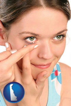 a young woman inserting a contact lens - with Delaware icon