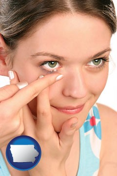 a young woman inserting a contact lens - with Iowa icon