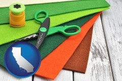 california craft supplies (colorful felt and a pair of scissors)