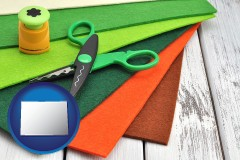 colorado craft supplies (colorful felt and a pair of scissors)