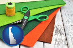 de map icon and craft supplies (colorful felt and a pair of scissors)