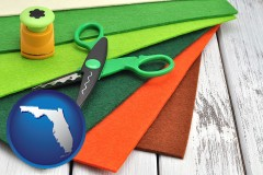 florida craft supplies (colorful felt and a pair of scissors)
