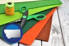 montana craft supplies (colorful felt and a pair of scissors)