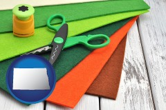 north-dakota craft supplies (colorful felt and a pair of scissors)