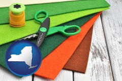 new-york craft supplies (colorful felt and a pair of scissors)