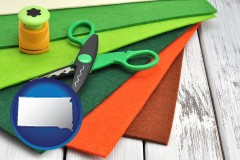 south-dakota craft supplies (colorful felt and a pair of scissors)