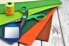 wy map icon and craft supplies (colorful felt and a pair of scissors)