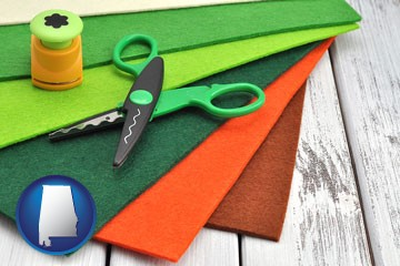 craft supplies (colorful felt and a pair of scissors) - with Alabama icon