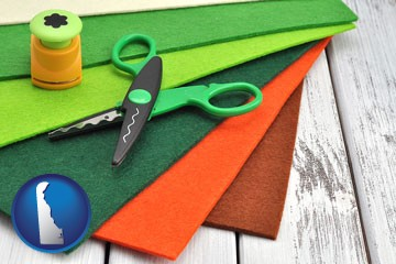 craft supplies (colorful felt and a pair of scissors) - with Delaware icon