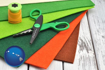 craft supplies (colorful felt and a pair of scissors) - with Hawaii icon