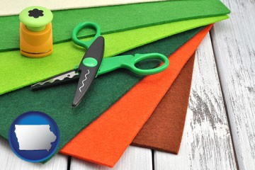 craft supplies (colorful felt and a pair of scissors) - with Iowa icon