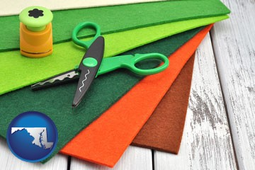 craft supplies (colorful felt and a pair of scissors) - with Maryland icon