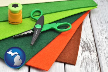 craft supplies (colorful felt and a pair of scissors) - with Michigan icon