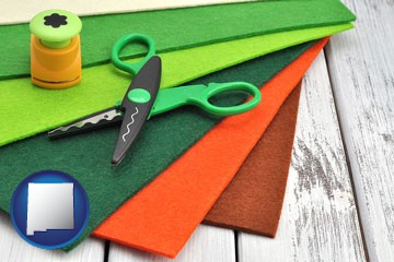 craft supplies (colorful felt and a pair of scissors) - with New Mexico icon