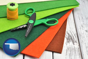craft supplies (colorful felt and a pair of scissors) - with Oklahoma icon