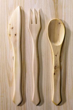 a wooden knife, fork, and spoon